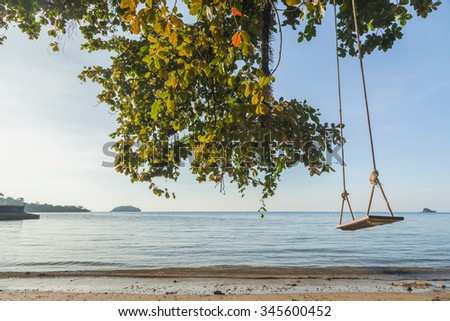 Tropical sea beach with swing tied, Thailand - stock photo