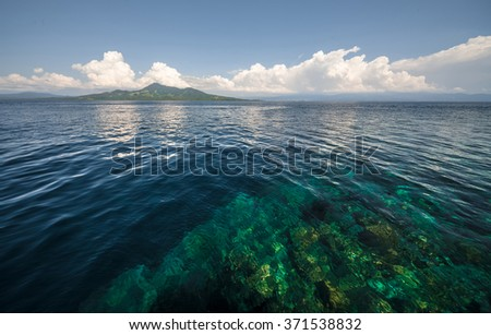 Tropical sea near the island of Bunaken with bright coral reefs. Indonesia