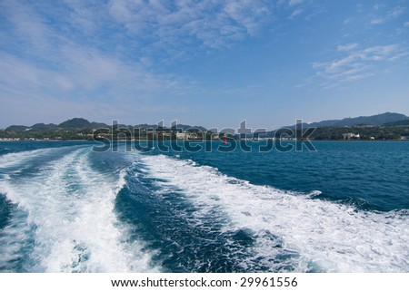 Tropical sea of Okinawa seen from a ferry - stock photo