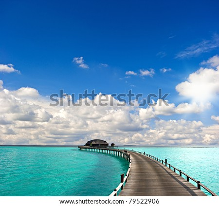 tropical seascape. over-water bungalow - stock photo