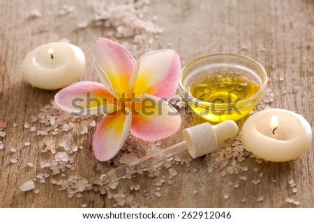 Tropical setting on wooden with pile of salt