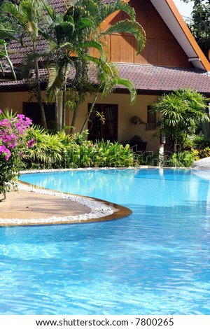 Tropical spa resort with a swimming pool in Phuket, Thailand - travel and tourism. - stock photo