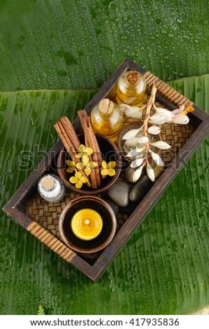 Tropical spa setting and banana leaf  - stock photo