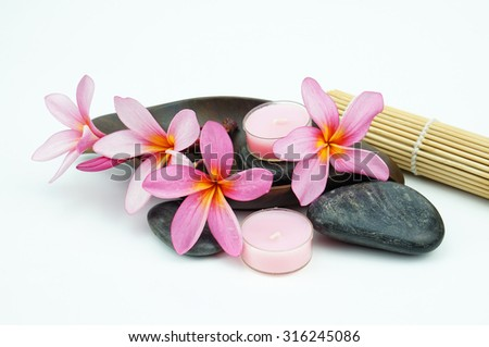 Tropical spa setting isolated on white background - stock photo
