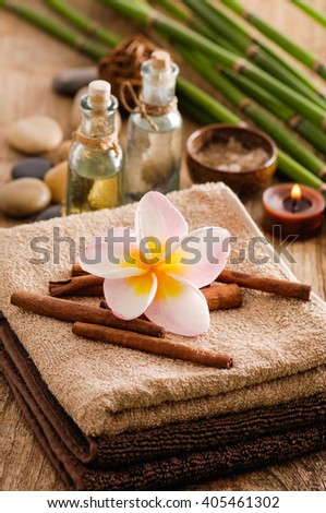 Tropical spa setting on old wood - stock photo