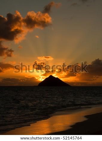 Tropical sunrise at Lanikai Beach, Oahu, Hawaii. - stock photo