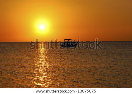Tropical Sunset and Boat - stock photo