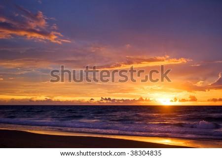 Tropical sunset on the beach - stock photo