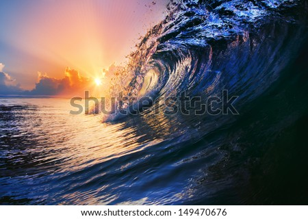 tropical sunset summer design template beautiful ocean surfing wave closing with drops and splashes - stock photo