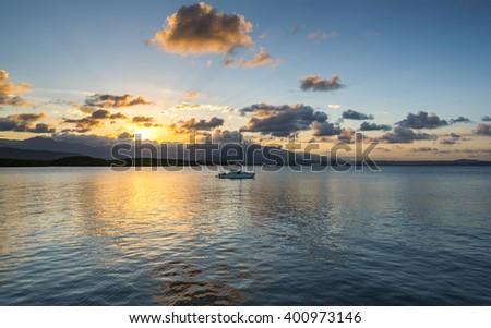 tropical sunset wet tropics Coral sea Port Douglas - stock photo