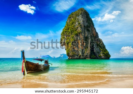 Tropical vacation holiday beach concept - Long tail boat on tropical beach, Krabi, Thailand - stock photo