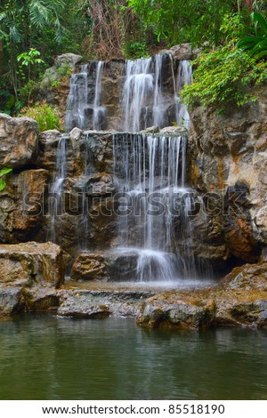 Tropical waterfall in Thailand forest - stock photo