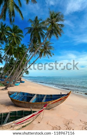 tropical white beach Vietnam with palm trees and clouds - stock photo