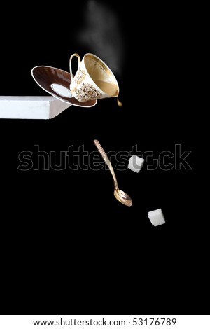 Trouble! Falling of a cup of coffee from a table. - stock photo