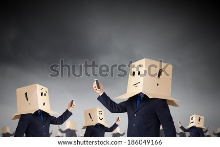 Troubled businessman with carton box on head expressing emotions - stock photo
