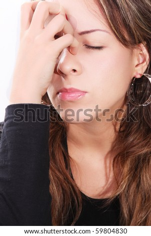 Troubled young woman with her hand on her face