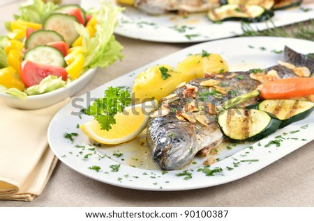 Trout amandine (fried trout with butter, lemon and almonds) - stock photo