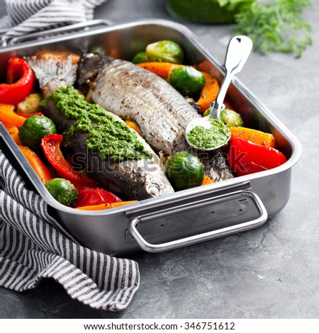 Trout baked with vegetables, selective focus - stock photo