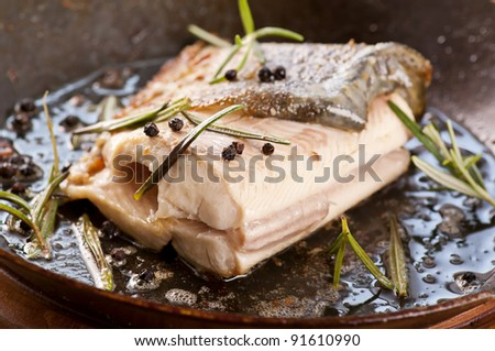 trout fried in the iron pan - stock photo