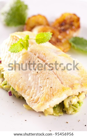 trout fried with avocado tatar - stock photo
