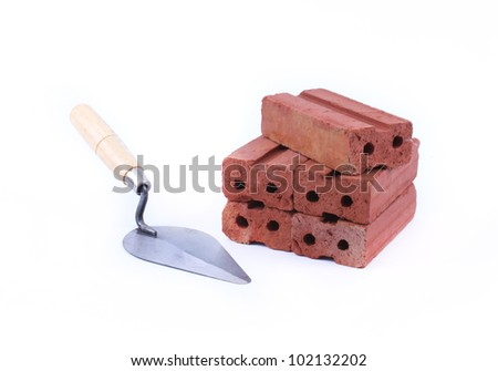 Trowel and red brick isolated on white background - stock photo