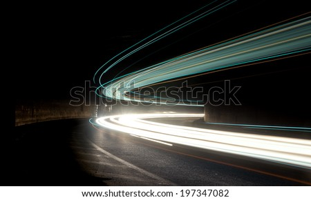Truck and car light trails in tunnel. Art image . Long exposure photo taken in a tunnel  - stock photo