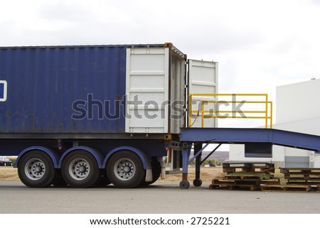 Truck backed onto loading dock - stock photo