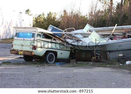 Truck & boat destroyed by Hurricane Katrina.