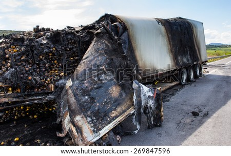 Truck burnt and abandoned along the road - stock photo
