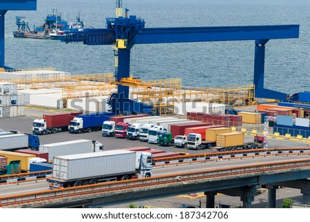 truck carries container to warehouse near sea - stock photo