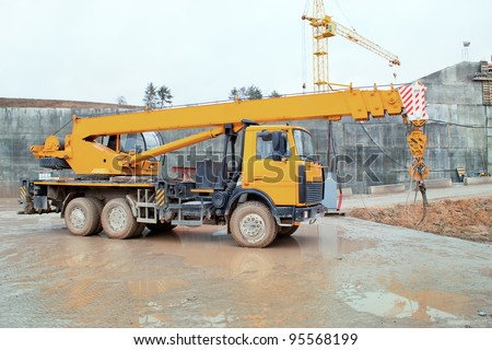 Truck crane standing on a construction site under construction hydropower plants in Grodno Belarus - stock photo