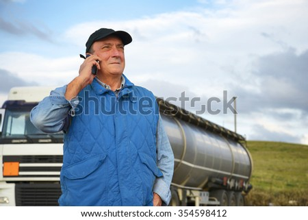 Truck driver phoning - stock photo