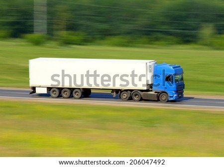 truck driving on a road - slow shutter  - stock photo