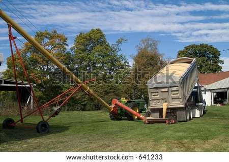 truck dumping a load of soybeans - stock photo