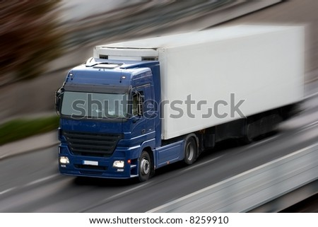 Truck going fast on the road with motion blur - stock photo
