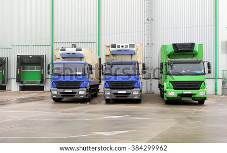 Truck in unloading in warehouse - stock photo