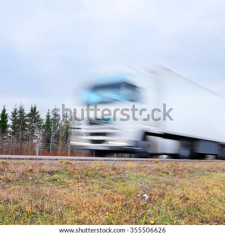 Truck on a hughway. Truck is blurred because of movement - stock photo