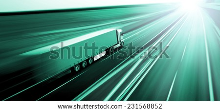 Truck on asphalt road motion blur  - stock photo