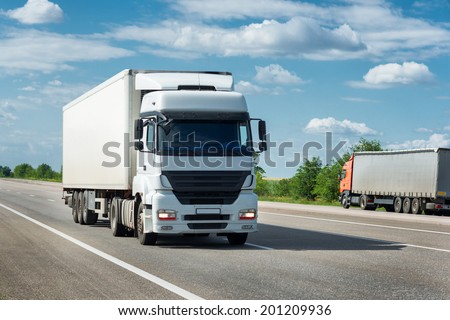 truck on road. cargo transportation - stock photo