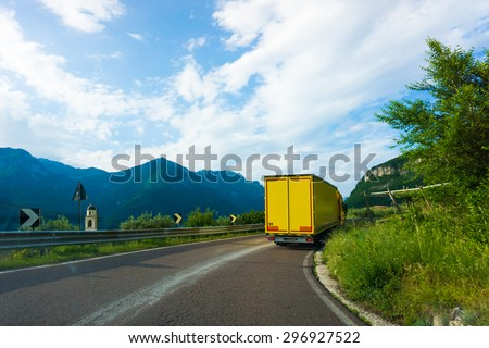 truck on road. cargo transportation.  Yellow truck - stock photo
