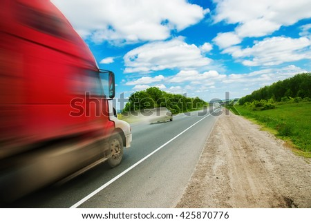 Truck on Road Summer Landscape Transportation Far Distances - stock photo