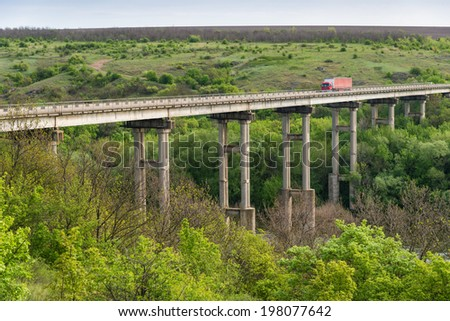 Truck on the countryside bridge - stock photo