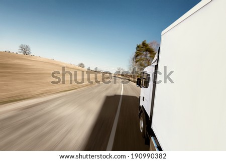 Truck on the road. 3D render on photographic background. - stock photo