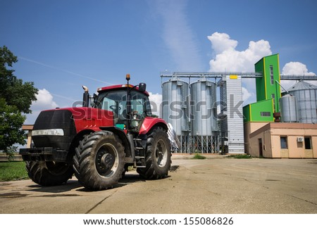Truck parked in front of grain silos - stock photo