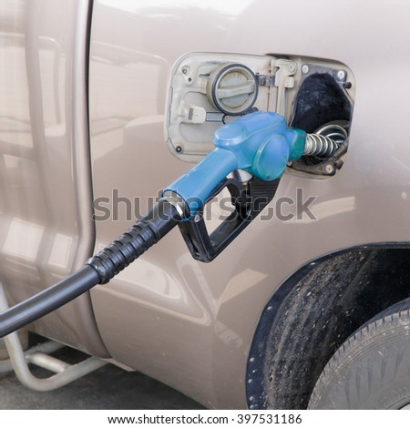 Truck refueling on a petrol station.