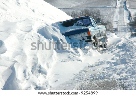 Truck Stuck in a Blizzard Snow Drift - stock photo