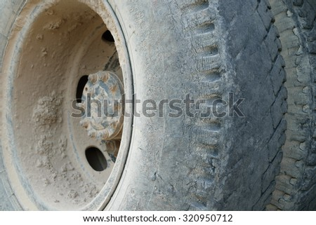 Truck tire with soil dust - stock photo