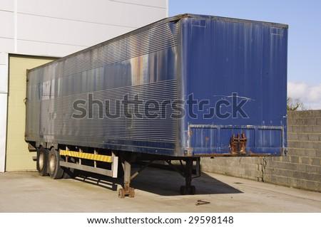 truck trailer at warehouse - stock photo