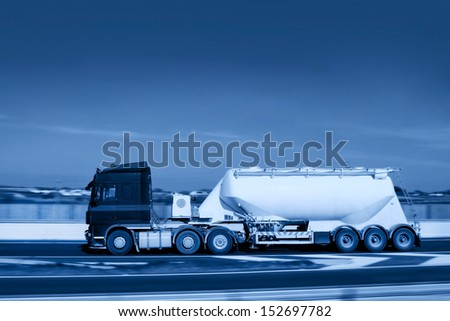 Truck With Limestone Flour Tank in motion on the road - stock photo