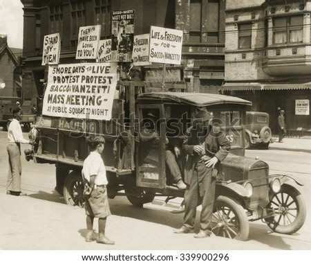 Truck with several protest signs five days prior to the executions of Sacco and Vanzetti. Signs read, '5 MORE DAYS TO LIVE, PROTEST PROTEST, SACCO & VANZETTI, MASS MEETING, At the public Square Tonigh - stock photo